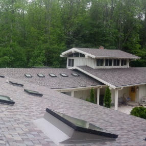 Large roofing company installs asphalt shingles in Milwaukee