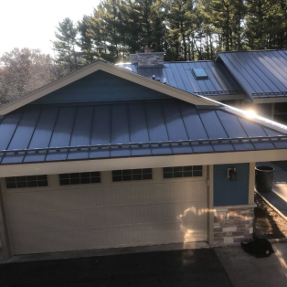 Steel roofing panel installation by Milwaukee contractors